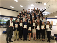 DECA Students Advance to State-Wide Competition photo