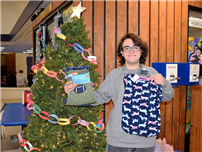 Northport High School Senior Runs Holiday Drive for Almost a Decade photo